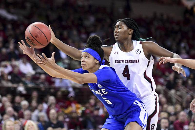 Duke forward Leaonna Odom (5) reaches for a rebound in front of South Carolina forward Aliyah Boston (4) during the first half of an NCAA college basketball game Thursday, Dec. 19, 2019, in Columbia, S.C. (AP Photo/Sean Rayford)