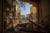 Destroyed buildings are seen from a room heavily damaged in a neighborhood near the site of last week's explosion that hit the seaport of Beirut Beirut, Lebanon, Wednesday, Aug. 12, 2020. (AP Photo/Hassan Ammar)