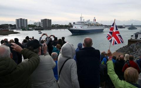 MV Boudicca leaves the harbour to great cheers - Credit: REUTERS/Hannah McKay