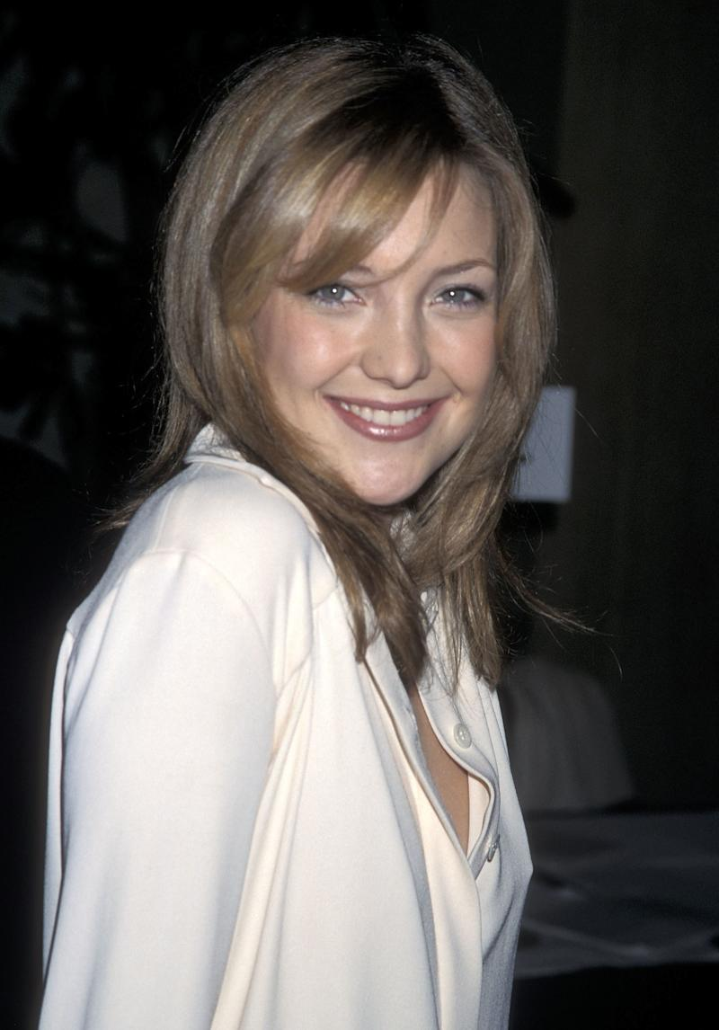 Wearing a mauve lip with her shoulder length locks and tousled bangs, Hudson attends the Hollywood Women's Press Club's 60th Annual Golden Apple Awards in 2000.