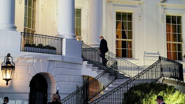 PHOTO: President Donald Trump climbs stairs after the president underwent a fourth day of treatment for the coronavirus disease (COVID-19) as he returns to the White House, Oct. 5, 2020. (Erin Scott/Reuters)