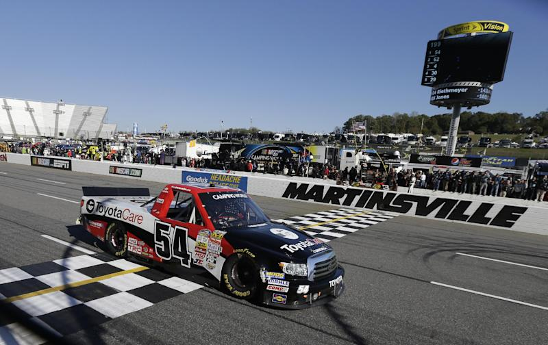 Darrell Wallace Jr. crosses the finish line to win the NASCAR Truck Series auto race at Martinsville Speedway in Martinsville, VA., Saturday, Oct. 26, 2013. (AP Photo/Steve Helber)