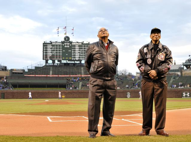 CHICAGO, IL - APRIL 16: Former Chicago Cubs and Hall-Of-Famers Ernie Banks (R) and Billy Williams stand on the field as they are honored before the game against the Texas Rangers at Wrigley Field on April 16, 2013 in Chicago, Illinois. All uniformed team members are wearing jersey number 42 in honor of Jackie Robinson Day. (Photo by Brian Kersey/Getty Images)