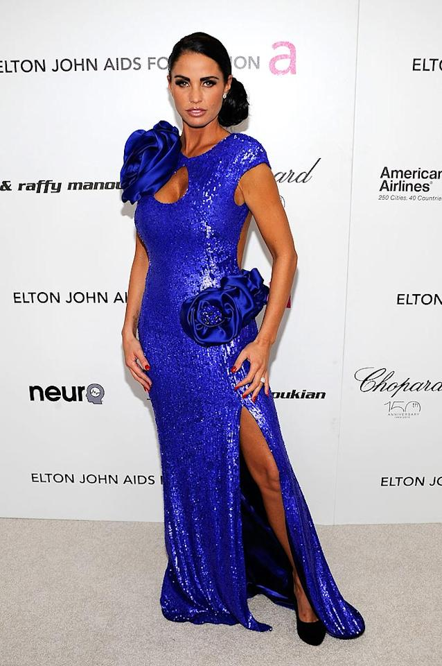 "British model Katie Price posed in a loud, sequined blue gown with giant flowers, but even that couldn't hide her too-tan skin. Larry Busacca/<a href=""http://www.gettyimages.com/"" target=""new"">GettyImages.com</a> - March 7, 2010"