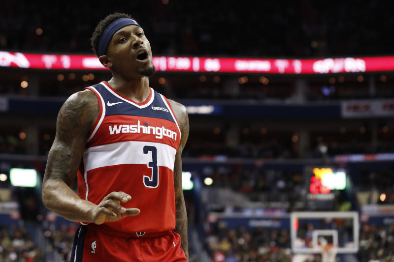 Apr 5, 2019; Washington, DC, USA; Washington Wizards guard Bradley Beal (3) talks to a fan in the stands against the San Antonio Spurs in the third quarter at Capital One Arena. Mandatory Credit: Geoff Burke-USA TODAY Sports