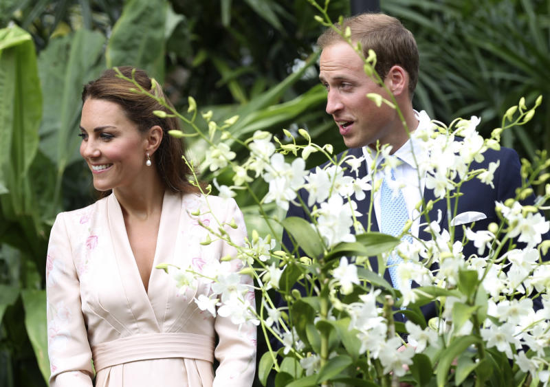 Prince William and his wife Kate, Duke and Duchess of Cambridge, view an orchid hybrid named after Diana, late Princess of Wales, during a tour the Orchid Garden within the Singapore Botanical Gardens in Singapore on Tuesday, Sept. 11, 2012. The British royal couple is on an official three-day trip to Singapore. (AP Photo/Stephen Morrison, Pool)
