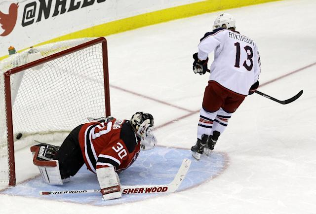 Columbus Blue Jackets right wing Cam Atkinson (13) scores a goal on New Jersey Devils goalie Martin Brodeur during a shootout in an NHL hockey game, Friday, Dec. 27, 2013, in Newark, N.J. The Blue Jackets won 2-1. (AP Photo/Julio Cortez)