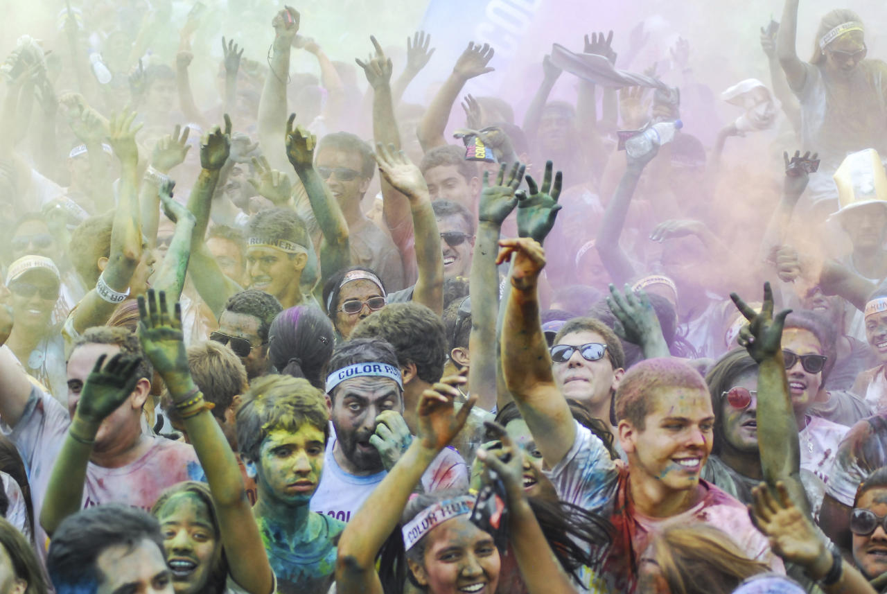 RIO DE JANEIRO, BRAZIL - DECEMBER 16: People celebrate during The Color Run on December 16, 2012 in Rio de Janeiro, Brazil. (Photo by Ronaldo Brandao/NewsFree/LatinContent/Getty Images)