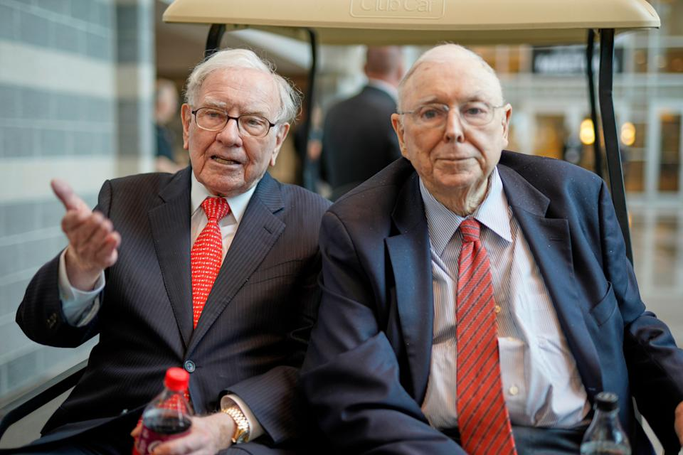 Berkshire Hathaway Chairman and CEO Warren Buffett, left, and Vice Chairman Charlie Munger, briefly chat with reporters Friday, May 3, 2019, one day before Berkshire Hathaway's annual shareholders meeting. An estimated 40,000 people are expected in town for the event, where Buffett and Munger preside over the meeting and spend hours answering questions. (AP Photo/Nati Harnik)