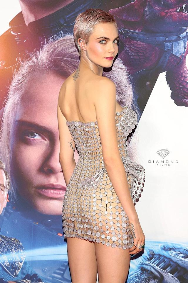 <p>Not many people can work a red carpet like Cara Delevingne. The model and actress rocked it again, showing off a pink pixie cut and an Atelier Versace dress at the Mexico City premiere of her latest movie, <i>Valerian and the City of a Thousand Planets</i>. (Photo: Victor Chavez/Getty Images) </p>