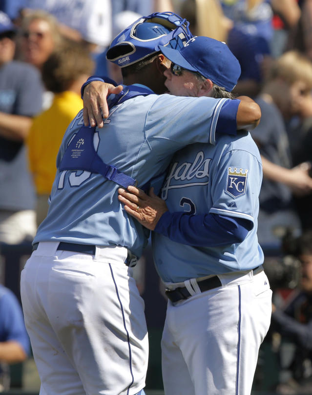 Kansas City Royals catcher Salvador Perez, left, gets a hug from manager Ned Yost following a baseball game against the Minnesota Twins at Kauffman Stadium in Kansas City, Mo., Saturday, April 19, 2014. The Royals defeated the Twins 5-4. (AP Photo/Orlin Wagner)