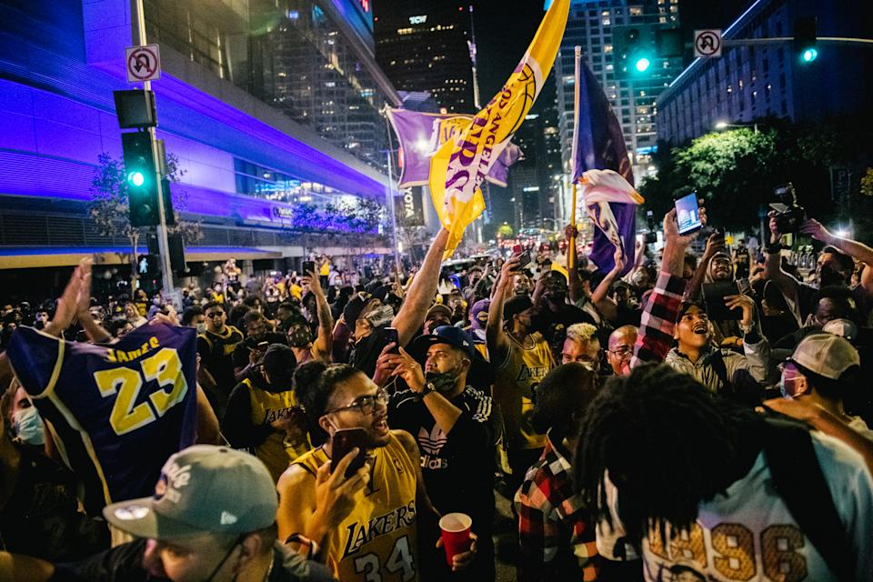 Lakers fans celebrate in front of the Staples Center after the team won the 2020 NBA Finals