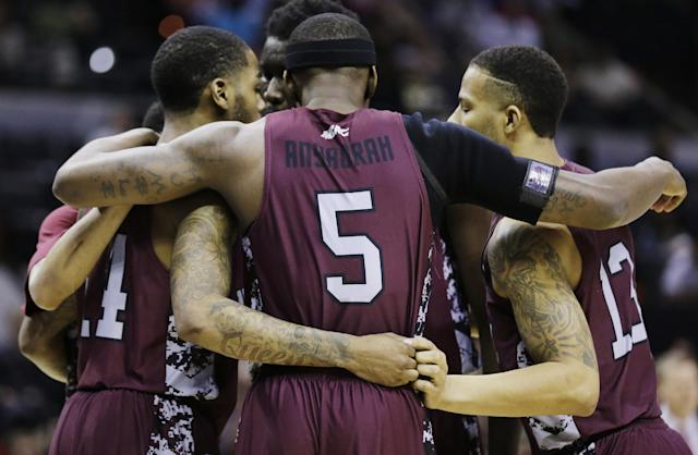 North Carolina Central players including guard Ebuka Anyaorah (5) and guard Reggie Groves (13) huddle against Iowa Stateduring the first half of a second-round game in the NCAA college basketball tournament Friday, March 21, 2014, in San Antonio. (AP Photo/Eric Gay)
