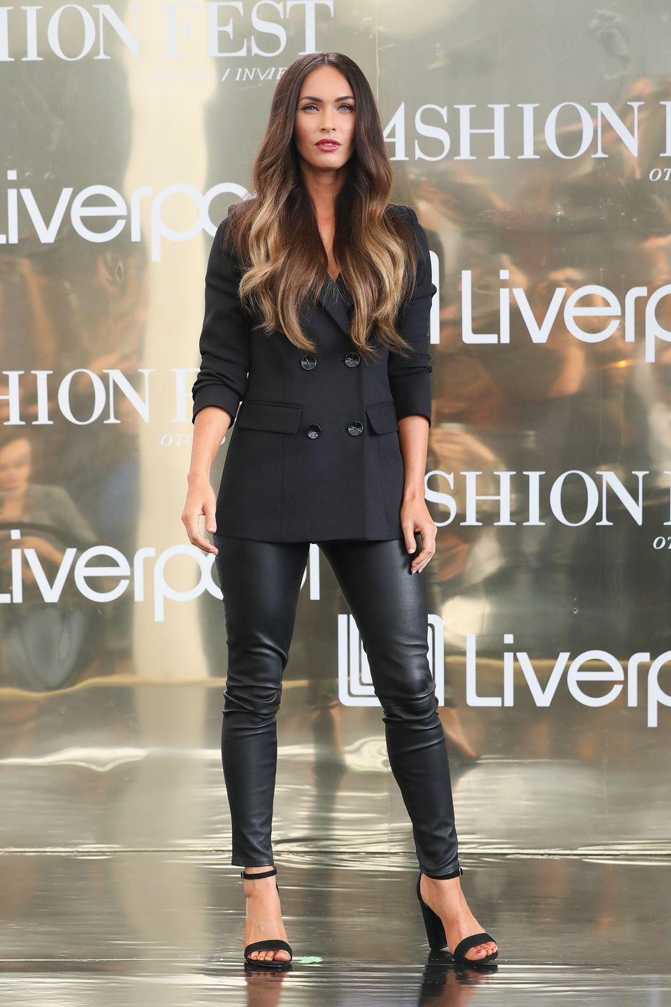 <p>Fox was spotted at a press conference in Mexico wearing a black tuxedo jacket, black leather trousers and black block heeled shoes. </p>