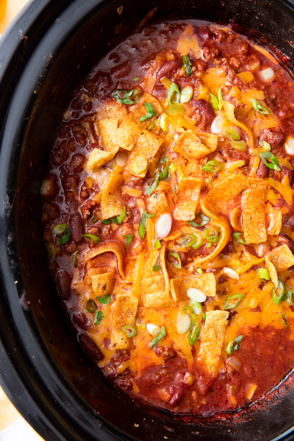 """<p>TBH, the chili is our favorite part of football season. </p><p>Get the recipe from <a href=""""https://www.delish.com/cooking/recipe-ideas/a21581186/slow-cooker-chili-recipe/"""" rel=""""nofollow noopener"""" target=""""_blank"""" data-ylk=""""slk:Delish"""" class=""""link rapid-noclick-resp"""">Delish</a>. </p>"""