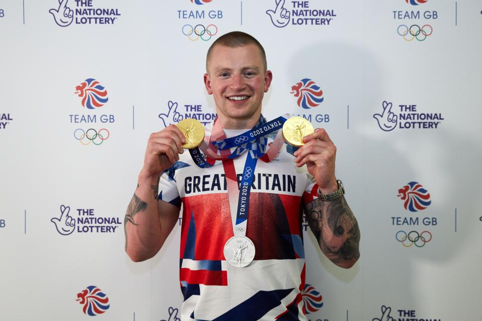 LONDON, ENGLAND - AUGUST 02: Adam Peaty poses for a photograph with his medals during the National Lottery's event celebrating