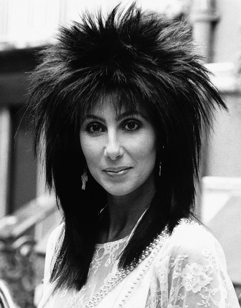 (Original Caption) Cher Arrives In London, 1985. American singer/actress Cher has arrived in London to promote her latest film 'Mask' in which she plays a mother struggling against the problems of bringing up a deformed child. (Photo by � Hulton-Deutsch Collection/CORBIS/Corbis via Getty Images)