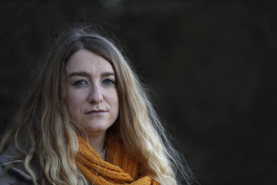 Jo Goodman poses for a portrait in London, Friday, Jan. 22, 2021. Jo's father Stuart died of COVID-19, in April 2020. A couple of months after her father died, Goodman, 32, co-founded the COVID-19 Bereaved Families for Justice group to pressure the government to back a public inquiry into how the pandemic was handled last spring. (AP Photo/Alastair Grant)