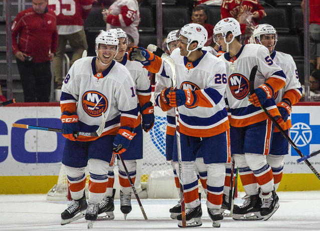 New York Islanders forward Anthony Beauvillier, left, celebrates his winning goal with teammates, in overtime of a preseason NHL hockey game against the Detroit Red Wings, Friday, Sept. 20, 2019, in Detroit. (AP Photo/Tony Ding)