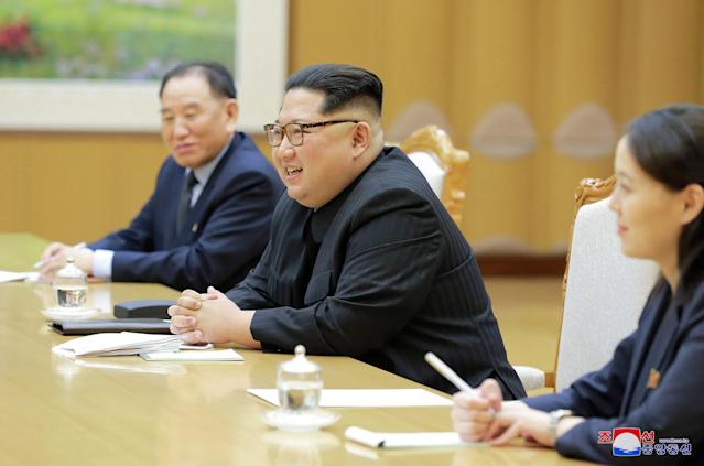 North Korean leader Kim Jong Un, center, his sister Kim Yo-jong and Kim Yong Chol, vice chairman of North Korea's ruling Workers' Party Central Committee, meet members of the South Korean delegation. (Photo: Korean Central News Agency/Korea News Service via AP)