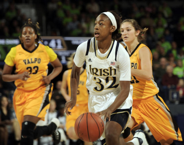 Notre Dame guard Jewell Loyd, middle, drives the lane as Valparaiso's Lexi Miller, right, and Sharon Karungi chase during the first half of an NCAA college basketball game Saturday, Nov. 16, 2013, in South Bend, Ind. (AP Photo/Joe Raymond)