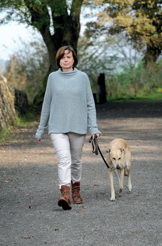 Rosie Ayliffe takes her dog for a walk.