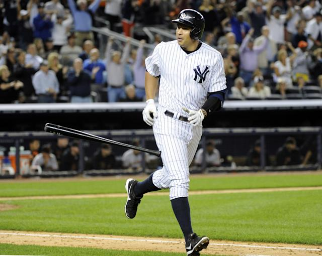 New York Yankees' Alex Rodriguez flips his bat after hitting a grand slam during the seventh inning of an interleague baseball game against the San Francisco Giants, Friday, Sept. 20, 2013, at Yankee Stadium in New York. (AP Photo/Bill Kostroun)