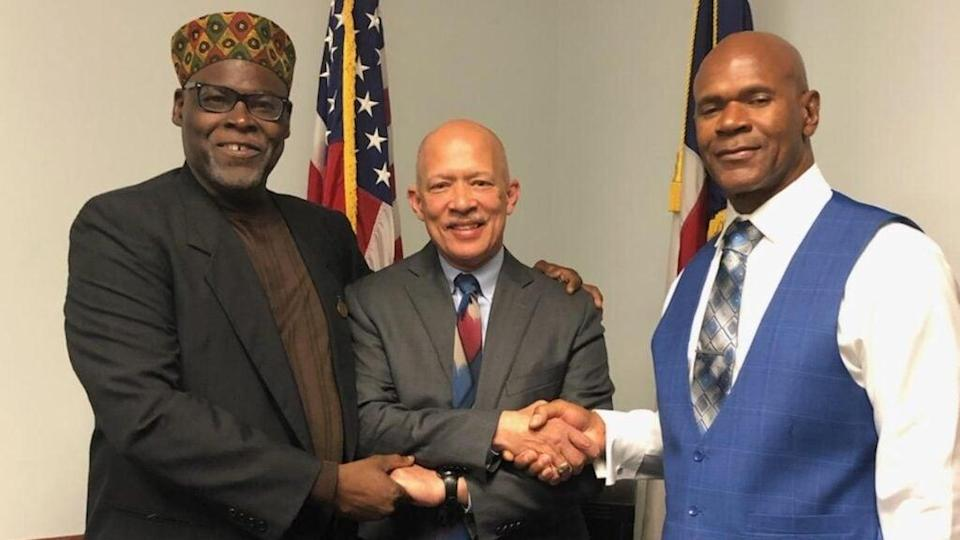 """In this 2019 photo, (from left) Stanley Mozee, Dallas County D.A. John Creuzot and Dennis Allen are shown the day Mozee and Allen were declared """"actually innocent"""" from a murder for which they served 15 years in prison. (The Innocence Project)"""