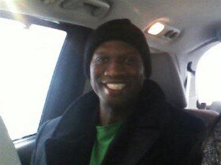 "Aaron Alexis, who the FBI believe to be responsible for the September 16, 2013 shootings at the Washington Navy Yard in Washington, D.C., is shown in this undated handout photograph provided by Kristi Suthamtewakul, wife of ""Happy Bowl"" Thai restaurant owner Nutpisit Suthamtewakul, was best friends with Alexis when he lived in White Settlement, Texas. REUTERS/Kristi Suthamtewakul/Handout via Reuters"