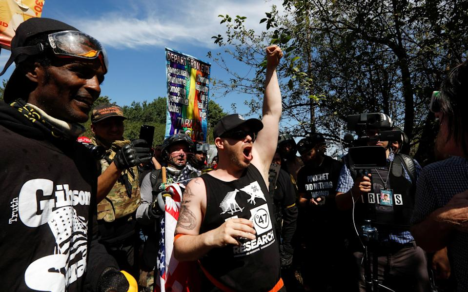 <p>Supporters of the Patriot Prayer group cheer during a rally in Portland, Ore., Aug. 4, 2018. (Photo: Bob Strong/Reuters) </p>