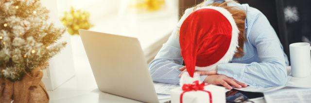 woman tired, asleep working at computer at Christmas