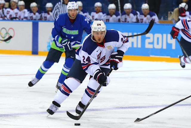 SOCHI, RUSSIA - FEBRUARY 16: Ryan Callahan #24 of the United States handles the puck against Rok Ticar #24 of Slovenia in the first period during the Men's Ice Hockey Preliminary Round Group A game on day nine of the Sochi 2014 Winter Olympics at Shayba Arena on February 16, 2014 in Sochi, Russia. (Photo by Martin Rose/Getty Images)