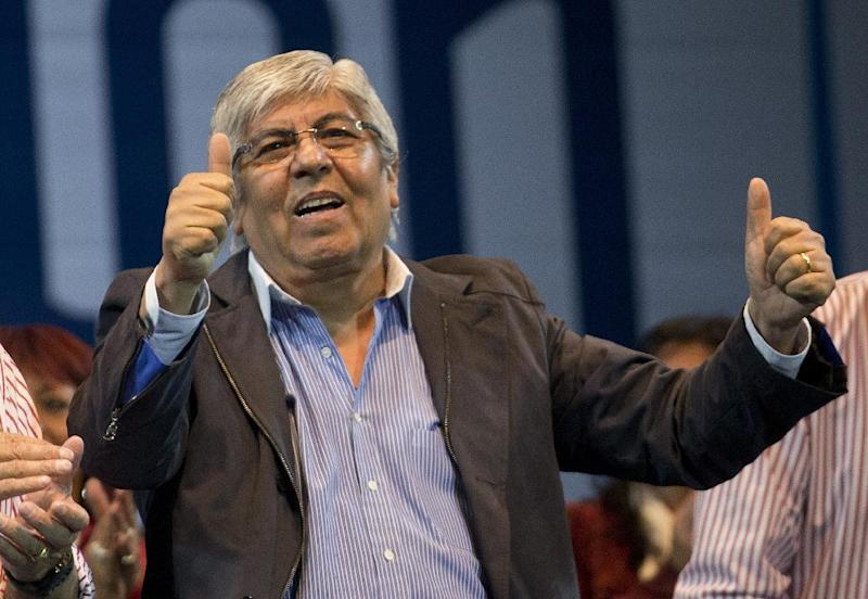 "Union leader Hugo Moyano gives thumbs up at an event launching his new political party in Buenos Aires, Argentina, Tuesday, May 7, 2013. Moyano, a critic of Argentine President Cristina Fernandez, created the new party ""Culture, Education and Jobs."" Moyano is a former ally of Fernandez and plans to run lists of candidates under his banner in October's midterm elections. (AP Photo/Victor R. Caivano)"