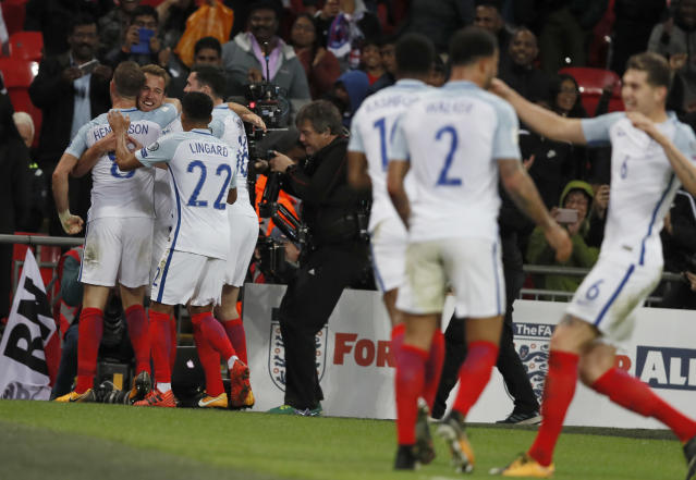 England's Harry Kane, 2nd left, celebrates after scoring the opening goal during the World Cup Group F qualifying soccer match between England and Slovenia at Wembley stadium in London, Thursday, Oct. 5, 2017. (AP Photo/Kirsty Wigglesworth)