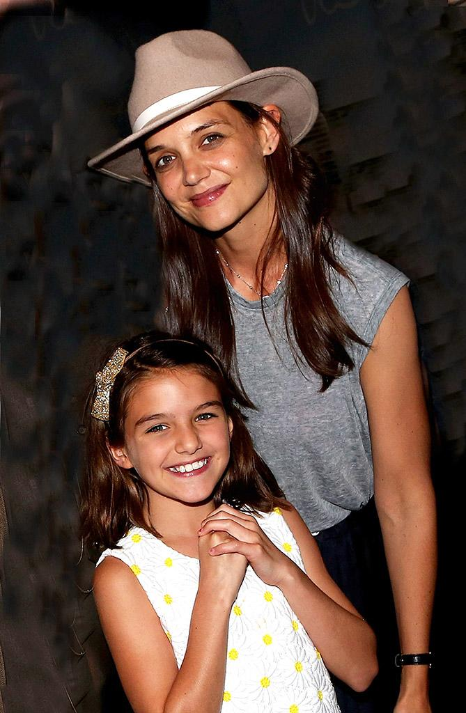 Suri Cruise and Katie Holmes pose at Finding Neverland