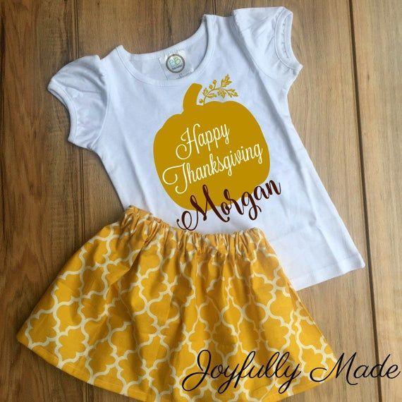 """<p><strong>Joyfully Made Boutique</strong></p><p>etsy.com</p><p><strong>$16.60</strong></p><p><a href=""""https://go.redirectingat.com?id=74968X1596630&url=https%3A%2F%2Fwww.etsy.com%2Flisting%2F637180668%2Fhappy-thanksgiving-skirt-set&sref=https%3A%2F%2Fwww.goodhousekeeping.com%2Fholidays%2Fthanksgiving-ideas%2Fg23100250%2Fbest-baby-thanksgiving-outfits%2F"""" rel=""""nofollow noopener"""" target=""""_blank"""" data-ylk=""""slk:Shop Now"""" class=""""link rapid-noclick-resp"""">Shop Now</a></p><p>This handmade-to-order outfit lets you put your child's name or age on the shirt, then finishes it off with a patterned skirt. Note: The word """"joyfully"""" is not actually printed on the skirt. </p>"""