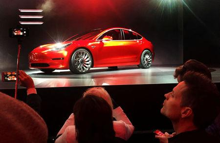 A Tesla Model 3 sedan is displayed during its launch in Hawthorne