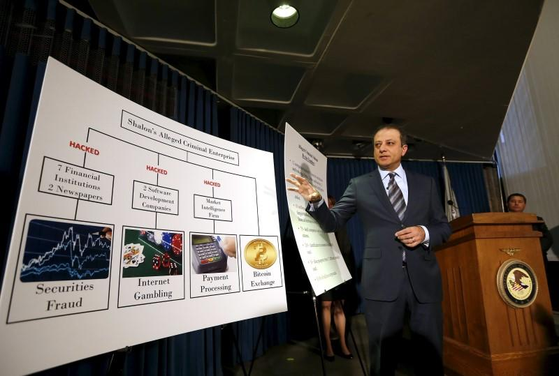 Preet Bharara, U.S. Attorney for the Southern District of New York, speaks next to a chart during a news conference New York