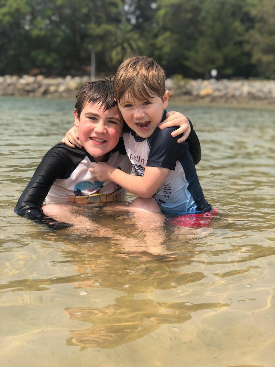 Pictured is Riley (left) and Tarek swimming, which mother Vanessa Brown says is the best form of exercise for them.