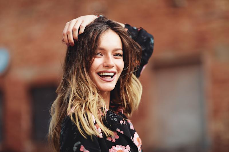 Portrait of beautiful young woman smiling outdoor