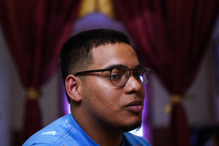 """Mino Zuniga Gonzales, 19, speaks during an interview with The Associated Press in the Kensington section of Philadelphia, Sunday, May 16, 2021. Gonzales and his brother are trying to rebuild their lives together with their mother Keldy Mabel Gonzales Brebe, a 37-year-old Honduran immigrant, after they were separated under a former """"zero-tolerance"""" policy to criminally prosecute adults who entered the country illegally. (AP Photo/Matt Rourke)"""