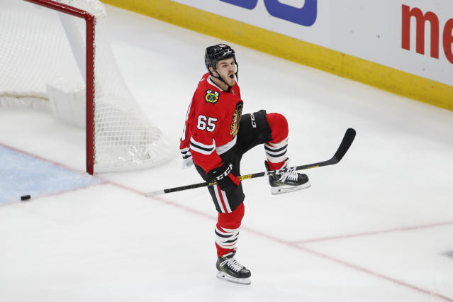 Chicago Blackhawks center Andrew Shaw celebrates after scoring against the San Jose Sharks during the second period of an NHL hockey game Thursday, Oct. 10, 2019, in Chicago. (AP Photo/Kamil Krzaczynski)