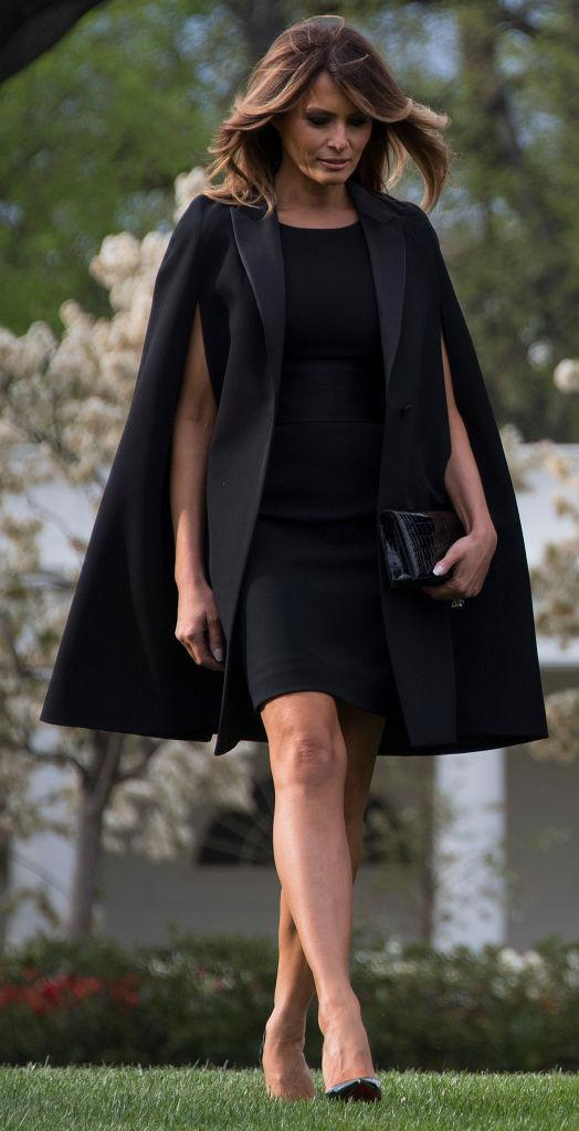The first lady wore a gorgeous Givenchy cape for the French president's arrival. (Photo: Getty Images)
