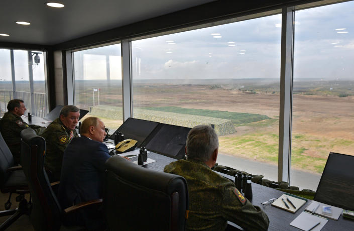 Russian President Vladimir Putin, second right, Russian Defense Minister Sergei Shoigu, right, and Russian General Staff Valery Gerasimov, second left, watch the joint strategic exercise of the armed forces of the Russian Federation and the Republic of Belarus Zapad-2021 at the Mulino training ground in the Nizhny Novgorod region, Russia, Monday, Sept. 13, 2021. The military drills attend by servicemen of military units and divisions of the Western Military District, representatives of the leadership headquarters and personnel of military contingents of the armed forces of Armenia, Belarus, India, Kazakhstan, Kyrgyzstan and Mongolia. (Alexei Druzhinin, Sputnik, Kremlin Pool Photo via AP)