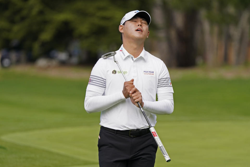 Si Woo Kim, of South Korea, reacts after missing a birdie putt on the sixth green of the Spyglass Hill Golf Course during the second round of the AT&T Pebble Beach Pro-Am golf tournament Friday, Feb. 12, 2021, in Pebble Beach, Calif. (AP Photo/Eric Risberg)