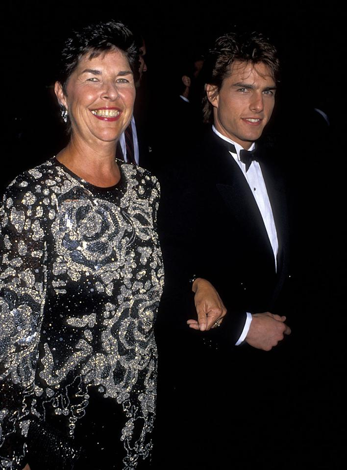 """<p>Tom Cruise and Mary Lee South at the 1990 Golden Globes. She was no pushy stage mom, but she encouraged her lookalike son to explore the arts. As someone who dreamed of performing herself, she suggested he try out for his high school's production of """"Guys and Dolls,"""" and he had her blessing when he decided he wanted to move to Hollywood. (Photo: Ron Galella, Ltd./WireImage) </p>"""