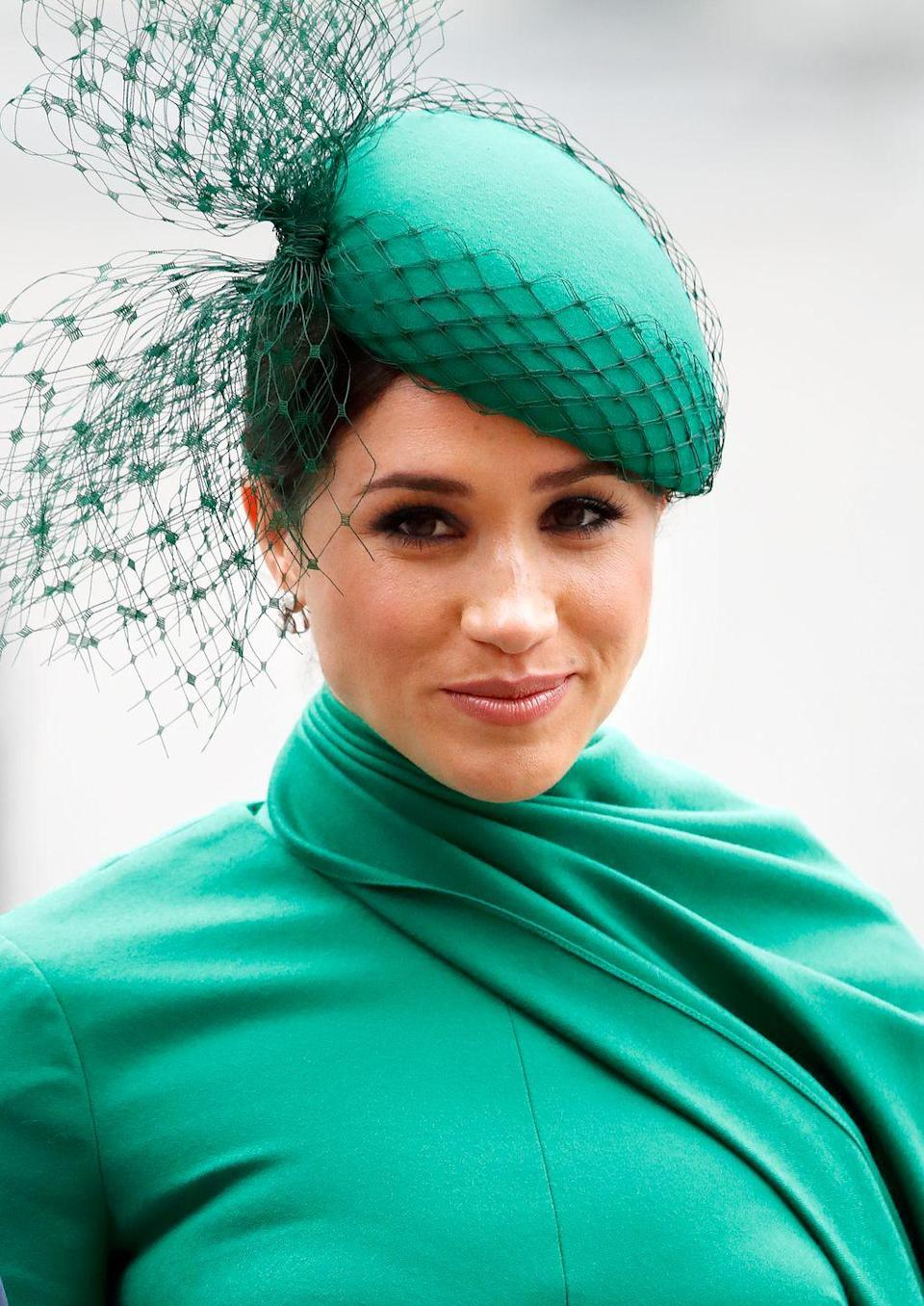 "<p>During one of <a href=""https://www.townandcountrymag.com/style/fashion-trends/a31351877/meghan-markle-final-royal-fashion-bold-looks/"" rel=""nofollow noopener"" target=""_blank"" data-ylk=""slk:her final appearances as a working royal"" class=""link rapid-noclick-resp"">her final appearances as a working royal</a>, the Duchess of Sussex stunned in an emerald Emilia Wickstead dress and matching fascinator by William Chambers.<br></p>"