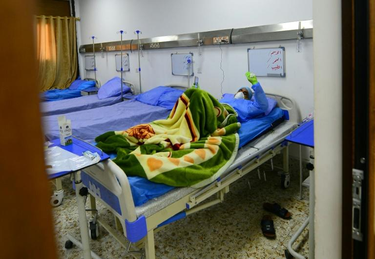An Iraqi coronavirus patient is hospitalised in Najaf on March 25