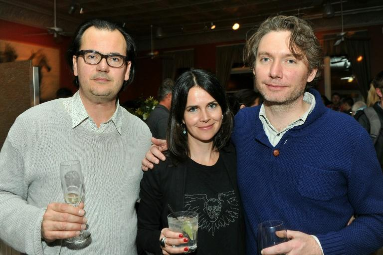 "MacDonald (right) with fellow filmmakers Joe Walker and Liza Marshell at the premier of ""Life In A Day,"" the original movie which involved less footage about sadness and loss, says the director"