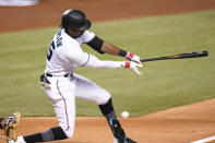 Miami Marlins' Lewis Brinson strikes out swinging during the second inning of the team's baseball game against the San Diego Padres, Thursday, July 22, 2021, in Miami. (AP Photo/Lynne Sladky)